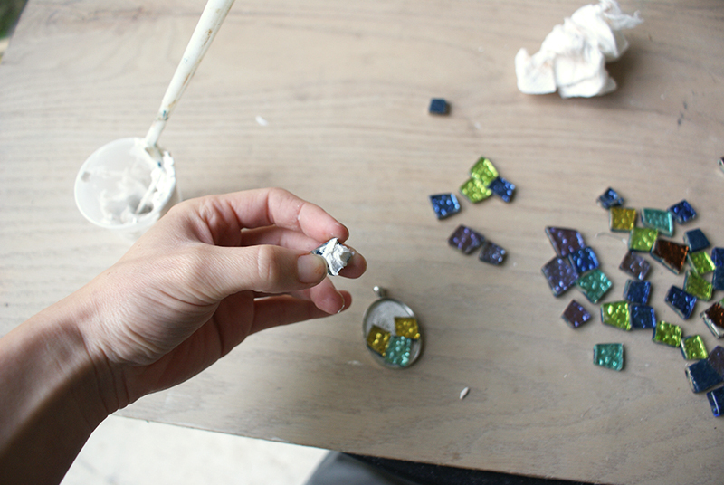 Diy mosaic pendant bohemian mint its simple pick the glass you like and arrange it in the setting i highly recommend settling on a design before gluing dip in the tile glue and place in aloadofball Choice Image